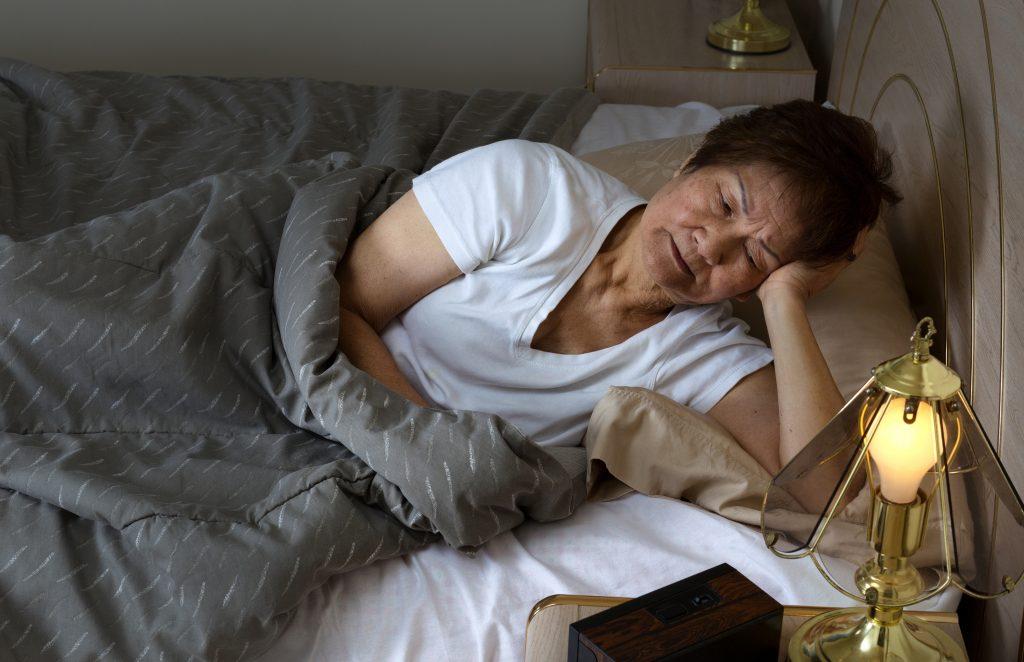 Restless woman Insomnia neuropathy diabetes